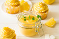 Preparing lemon cupcakes with citrus curd Royalty Free Stock Photo