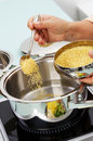 Preparing millet for cooking Stock Photography