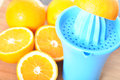 Preparing orange juice using squeezer Royalty Free Stock Image