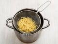Preparing pasta. Macaroni in the colander Royalty Free Stock Photo