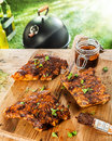 Preparing ribs for a bbq with savory basting sauce and finely chopped fresh herbs three portions on table jar of Royalty Free Stock Images