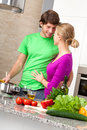 Preparing romantic dinner together in kitchen vertical Stock Image