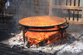 Preparing traditiona big paella on the beach traditional way with all kinds of sea food and rice andalusia spain Stock Photography