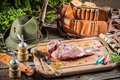 Preparing venison by a hunter on old wooden cutting board Royalty Free Stock Images