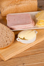 Preparing a whole wheat sandwich with ham and cheese Royalty Free Stock Photography