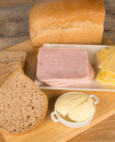 Preparing a whole wheat sandwich with ham and cheese Royalty Free Stock Image