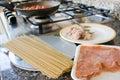 Preparing wholemeal spaghetti with smoked salmon Royalty Free Stock Photo