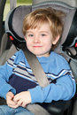 Preschool age boy in a booster seat Stock Photography