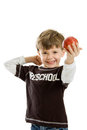 Preschool boy with apple Stock Image