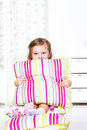 Preschool girl sitting on the pillows Stock Photo