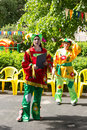 Preschool teacher entertain children in suits of buffoons at the moscow june festival Royalty Free Stock Images