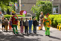 Preschool teacher entertain children in suits of buffoons at the moscow june festival Stock Images