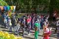 Preschool teacher entertain children in suits of buffoons at the moscow june festival Royalty Free Stock Photos