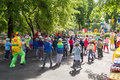 Preschool teacher entertain children in suits of buffoons at the moscow june festival Stock Image