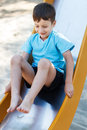Preschooler boy on slide outdoors childhood Stock Images