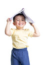 Preschooler child with a book over his head isolated white background Stock Images