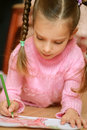 Preschooler draws a pencil on paper Royalty Free Stock Photos