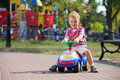 Preschooler driving his toy vehicle Stock Photo