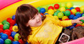 Preschooler girl with ball in play room. Royalty Free Stock Photo
