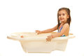 Preschooler girl in bath tub bathtub isolated on white background Stock Images