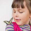 Preschooler girl with papilio machaon Royalty Free Stock Photo