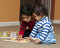 Preschooler showing Baby Sister Puzzle Stock Photography