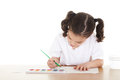 Preschooler stock image of female drawing with watercolors over white background Stock Photo