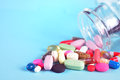 Prescription Pills and Medicine Medication Drugs spilling out of a bottle Royalty Free Stock Photo