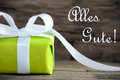 Present with alles gute green gift white decoration and the german words which means congratulations Stock Image