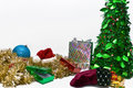 Present around Xmas tree Royalty Free Stock Images