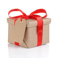 Present box from brown papaer with red ribbon bow Royalty Free Stock Photo