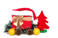 Present box with christmas decoration and santa claus hat on white background Royalty Free Stock Photo