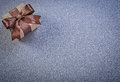 Present box in shop brown paper on grey background celebrations Royalty Free Stock Photo