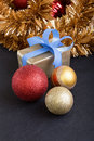 Present and christmas balls in black background vertical Royalty Free Stock Photo