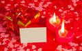 Present and two candles with blank card Stock Image
