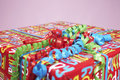 Present Wrapped With Colourful Paper And Curly Ribbon Royalty Free Stock Images