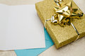 A Present Wrapped in Gold with a Card Royalty Free Stock Photo