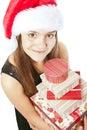 Presente sorridenti della holding della ragazza di natale sopra bianco Fotografia Stock Libera da Diritti