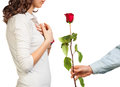 Presented a rose to girl on an isolated white background Stock Photo