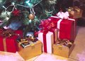 Presents boxes under the christmas tree gold red and white colours Stock Photography