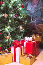Presents boxes under the christmas tree gold red and white colours Royalty Free Stock Images
