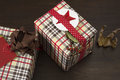 Presents wrapped in checkered paper and brown ribbon with label Royalty Free Stock Photo