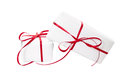 Presents wrapped in white paper and tied with red ribbon for christmas birthday wedding or valentine s day isolated Royalty Free Stock Images