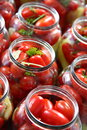 Preservation tomato tomatoes greens pepper sweet in glass jars preparation for Royalty Free Stock Images