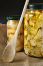 Preserve of pickled onions and artichokes Royalty Free Stock Photo