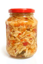 Preserved cabbage and red paprika salad in glass jar Royalty Free Stock Photo