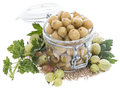 Preserved gooseberries on white portion of with some fresh fruits isolated Royalty Free Stock Photography