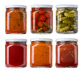 Preserved pickled vegetables and food ingredients in glass jars Royalty Free Stock Images