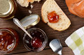 Preserves and bread high angle shot of on a rustic wooden kitchen table horizontal format with selective focus Royalty Free Stock Images
