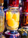 Preserves jars with traditional home made peach and other fruit and jams sold on a local market in georgia caucasus Royalty Free Stock Images